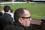 Harestanes AFC v Girvan FC, 15/08/2015. Scottish Cup preliminary round, Duncansfield Park. A spectator watching the first-half action as Harestanes AFC (in light blue) take on Girvan FC in a Scottish Cup preliminary round tie, staged at Duncansfield Park, home of Kilsyth Rangers. The home team were the first winners of the Scottish Amateur Cup to be admitted directly into the Scottish Cup in the modern era, whilst the visitors participated as a result of being members of both the Scottish Football Association and the Scottish Junior Football Association. Girvan won the match by 3-0, watched by a crowd of 300, which was moved from Harestanes ground as it did not comply with Scottish Cup standards. Photo by Colin McPherson.
