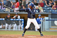 Asheville Tourists center fielder Raimel Tapia #15 awaits a pitch during a game against the Rome Braves at McCormick Field on May 1, 2014 in Asheville, North Carolina. The Tourists defeated the Braves 8-7. (Tony Farlow/Four Seam Images)
