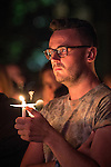 © Joel Goodman - 07973 332324 . 26/08/2013 . Manchester , UK . Candlelit vigil in memory of those who have died from AIDS , in Sackville Park Manchester this evening (Monday 26th August 2013) on the final evening of Manchester Pride 2013 . The annual event is organised by the George House Trust in Manchester . Photo credit : Joel Goodman