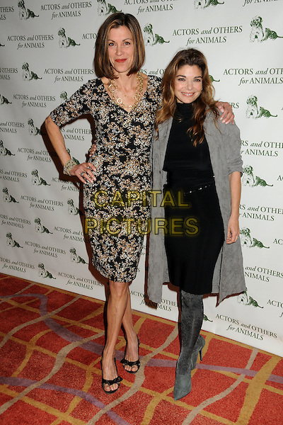 WENDIE MALICK & LAURA SAN GIACOMO .Actors and Others For Animals 40th Anniversary Fundraising Luncheon Honoring Betty White held at the Universal Hilton Hotel, Universal City, California, USA, 9th April 2011..full length dress hand on hip  grey gray coat  gold  necklace print black white beige  velvet boots .CAP/ADM/BP.©Byron Purvis/AdMedia/Capital Pictures.