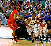 Chelsea Gray tries to go around Wolfpack defense. NC State defeated Duke 75-73 during quarter finals of the 2012 ACC Women's Basketball Tournament at the Greensboro Coliseum in Greensboro, NC. Photo by Al Drago.