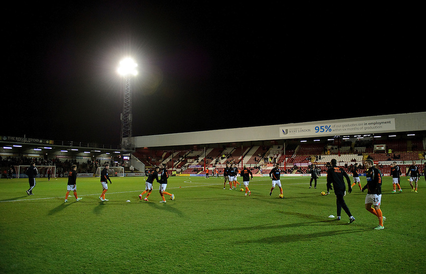Blackpool players during the pre-match warm-up <br /> <br /> Photographer Ashley Western/CameraSport<br /> <br /> Football - The Football League Sky Bet League One - Brentford v Blackpool - Tuesday 24th February 2015 - Griffin Park - London<br /> <br /> &copy; CameraSport - 43 Linden Ave. Countesthorpe. Leicester. England. LE8 5PG - Tel: +44 (0) 116 277 4147 - admin@camerasport.com - www.camerasport.com