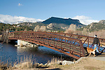 iron, bridge, Big Thompson River, woman, walking, dog, fall, November, morning, Lake Estes Trail, Estes Park, Colorado, Rocky Mountains, USA