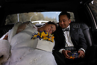 RIding in a limo on their way to the wedding on the Mendenhall Glacier in  the Tongass National Forest.  A couple who met on the internet decided to be married in an unusual way--the ride by helicopter onto the glacier.  Many are tourists--Anna Hall and John Bohach from California were married on the first sunny day in Juneau in three weeks.