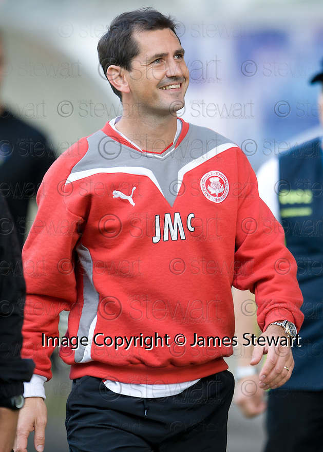 A happy Jackie McNamara makes his way back to the tunnel at the end of the game.