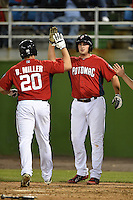 Potomac Nationals first baseman Shawn Pleffner (17) greets outfielder Brandon Miller (20) after a home run during a game against the Lynchburg Hillcats on April 26, 2014 at Pfitzner Stadium in Woodbridge, Virginia.  Potomac defeated Lynchburg 6-2.  (Mike Janes/Four Seam Images)