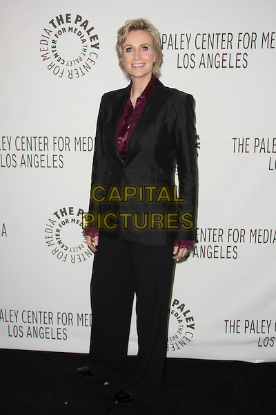 """JANE LYNCH.The PaleyFest 2011 Panel for """"Glee"""" held at The Saban Theater in Beverly Hills, California, USA..March 16th, 2011.full length grey gray black wide leg trousers jacket purple shirt blouse .CAP/ADM/TB.©Tommaso Boddi/AdMedia/Capital Pictures."""
