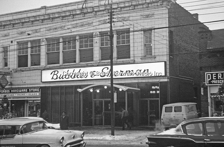 Pittsburgh PA - View of the Forbes Avenue business district in Squirrel Hill and the famous Bubbles and Sherman restaurant - 1962. Other stores on the block; Forbes Hardware Store, Klyne's Clothing Store, Oliver Flower Shop and Hanna Chapeaux