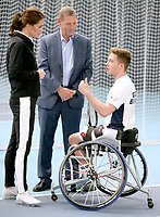 31 October 2017 - Princess Kate, Duchess of Cambridge talks with President of the LTA, Martin Corrie (C) and British tennis player Alfie Hewett (R) during a visit at the Lawn Tennis Association (LTA) at the National Tennis Centre in southwest London. Duchess of Cambridge visited the LTA, the national governing body of tennis, where she was briefed on the organisations latest activities and objectives, and had the opportunity to watch a number of tennis demonstrations at the National Tennis Centre's on-court facilities. Photo Credit: ALPR/AdMedia
