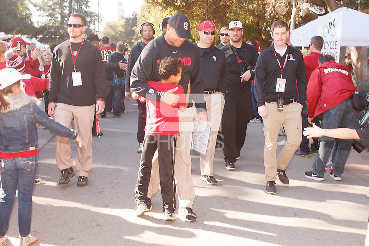 """STANFORD, CA -- November 23, 2013: David Shaw, head coach, gets a hug during """"The Walk"""" before the Stanford vs Cal football game Saturday afternoon at Stanford Stadium."""