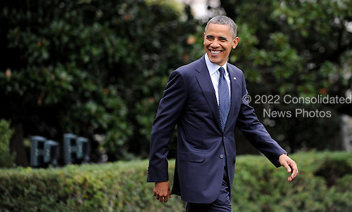United States President Barack Obama walks to Marine One on the South Lawn to depart the White House October 7, 2012 in Washington, DC. Obama is heading to a campaign event in Los Angeles, California..Credit: Olivier Douliery / Pool via CNP