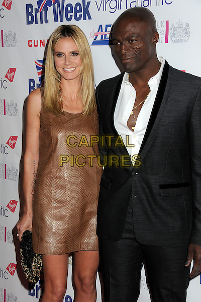 "HEIDI KLUM & SEAL.BritWeek 2011 Fundraising Gala Dinner Benefiting LA's BEST ""Joy of Reading"" held at L.A. Live, Los Angeles, California, USA..April 28th, 2011.half length dress leather clutch bag brown sleeveless  black suit white shirt married husband wife .CAP/ADM/BP.©Byron Purvis/AdMedia/Capital Pictures."