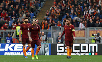 From left, Roma's Federico Fazio, Radja Nainggolan and Daniele De Rossi react after Napoli&rsquo;s Dries Mertens, not seen, scored his first goal during the Italian Serie A football match between Roma and Napoli at Rome's Olympic stadium, 4 March 2017. Napoli won 2-1.<br /> UPDATE IMAGES PRESS/Riccardo De Luca