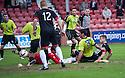 Pars' Luke Johnston (on ground, right) scores their second goal.