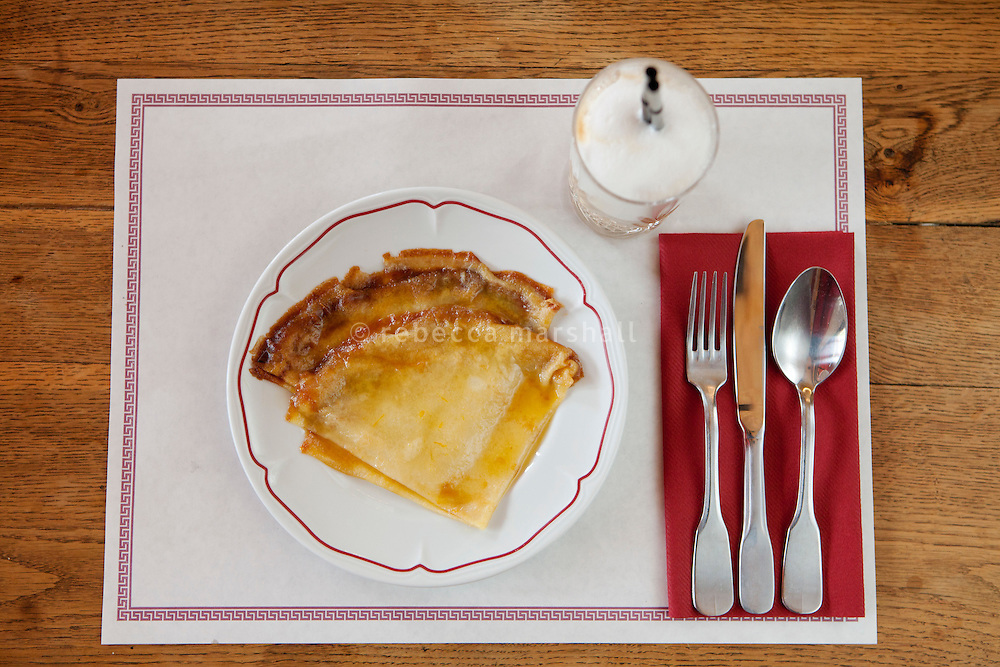 Crêpe suzette is served with a cappuccino at Bouchon restaurant, Monaco, 23 March 2012