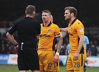 Newport County's Scot Bennett (left) and Mickey Demetriou protest the awarding of a penalty after a foul on Blackpool's Bright Osayi-Samuel (not in picture)<br /> <br /> Photographer Kevin Barnes/CameraSport<br /> <br /> The EFL Sky Bet League Two - Saturday 18th March 2017 - Newport County v Blackpool - Rodney Parade - Newport<br /> <br /> World Copyright &copy; 2017 CameraSport. All rights reserved. 43 Linden Ave. Countesthorpe. Leicester. England. LE8 5PG - Tel: +44 (0) 116 277 4147 - admin@camerasport.com - www.camerasport.com