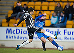 St Johnstone v St Mirren....22.01.11  .Peter MacDonald's shot is blocked by Darren McGregor.Picture by Graeme Hart..Copyright Perthshire Picture Agency.Tel: 01738 623350  Mobile: 07990 594431