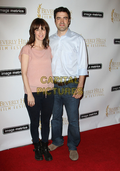 ROSEMARIE DeWITT & RON LIVINGSTON .2011 Beverly Hills Film Festival Opening Night Held At The Clarity Theatre, Beverly Hills, California, USA, .6th April 2011..full length pink top t-shirt couple husband wife jeans blue shirt  ankle boots .CAP/ADM/KB.©Kevan Brooks/AdMedia/Capital Pictures.