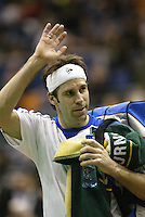 22-2-06, Netherlands, tennis, Rotterdam, ABNAMROWTT, Greg Rusedski waves to the public if he leaves the stadium after loosing to Davydenko