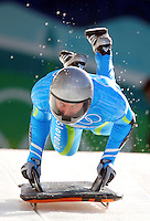 Slovenia's Anze Setina mounts his sled in men's skeleton at the XXI Olympic Winter Games Wednesday, February 17, 2010 at the Whistler Sliding Center in Whistler, British Columbia.