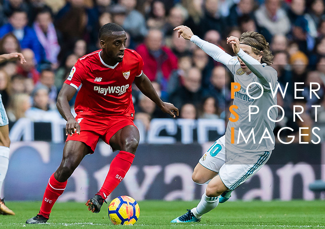 Lionel Jules Carole (l) of Sevilla FC fights for the ball with Luka Modric of Real Madrid during the La Liga 2017-18 match between Real Madrid and Sevilla FC at Santiago Bernabeu Stadium on 09 December 2017 in Madrid, Spain. Photo by Diego Souto / Power Sport Images