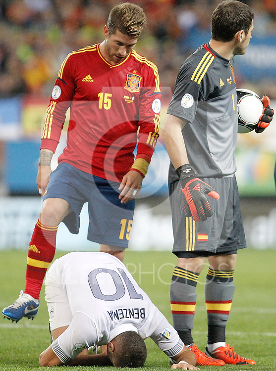 Spain's national team Sergio Ramos and France's national team Karim Benzema injured during match. October 16, 2012. (ALTERPHOTOS/Alvaro Hernandez)