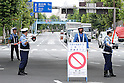 September 1, 2011, Tokyo, Japan - Japanese traffic police officers cordon off a major junction where all vehicles inbound for the city are halted during an emergency drill in Tokyo on Thursday, September 1, 2011. Drills were held throughout Japan with some 517,000 people participating in 35 prefectures, in the first such mass exercises since the catastrophic March quake and tsunami hit the country's northeast. (Photo by AFLO) [3609] -mis-