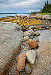 Deer Isle, Maine: Colorful rocks on the shoreline Jericho Bay