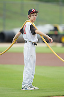Kannapolis Intimidators batboy Allan Westerholt helps water the infield prior to the South Atlantic League game against the Lakewood BlueClaws at CMC-NorthEast Stadium on July 20, 2014 in Kannapolis, North Carolina.  The Intimidators defeated the BlueClaws 7-6. (Brian Westerholt/Four Seam Images)