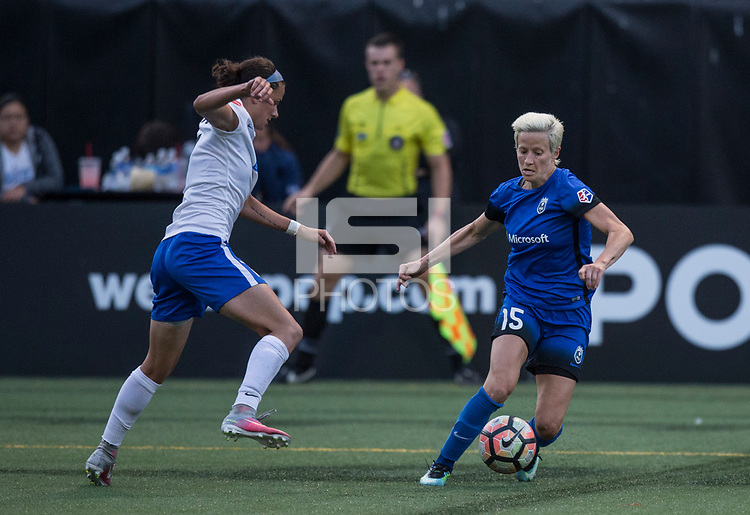 Seattle, WA - Saturday July 15, 2017: Amanda Frisbie, Megan Rapinoe during a regular season National Women's Soccer League (NWSL) match between the Seattle Reign FC and the Boston Breakers at Memorial Stadium.