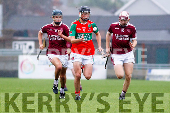 Crotta's Tomas O'Connor in possession as Causeways Gavin Dooly and Gearoid Mahony close down on him during the Cuaseway v Crotta O'Neills U21 Hurling championship final in Austin Stack Park on Saturday last.