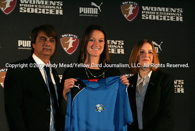 16 January 2009: Brittany Bock, with head coach Abner Rogers (left) and WPS Commissioner Tonya Antonucci (right), was taken by the Los Angeles Sol with the fifth overall pick. The 2009 inaugural Womens Pro Soccer (WPS) Draft was held at the Convention Center in St. Louis, Missouri in conjuction with the National Soccer Coaches Association of America's annual convention.