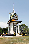 A Buddhist stupa at the Choeung Ek Genocidal Center near Phnom Penh, Cambodia honors the memory of an estimated 17,000 people who were murdered at this spot under the Khmer Rouge regime of 1975 to 1979. Choeung Ek is the best known of the more than 300 mass execution sites in Cambodia that came to be known as the Killing Fields. Most of those who passed through Tuol Sleng prison in Phnom Penh were later murdered and buried here. March 1, 2012.