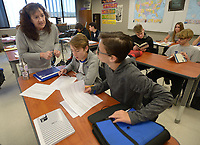 NWA Democrat-Gazette/ANDY SHUPE<br /> Julia Woodward (left), a teacher at Fayetteville High School, answers questions for Ian Kimbrow, and Paolo Shults, both 15-year-old ninth-graders, Friday, April 20, 2018, during class at at the school. Fayetteville High School was recently selected from over 1,000 schools worldwide to participate in the College Board&rsquo;s new Pre-AP Program for ninth grade students beginning in the 2018-2019 school year.
