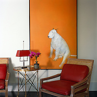 The living room is dominated by a painting of a bull terrier by artist Ray Richardson entitled 'Tangerine'