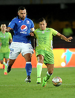BOGOTA - COLOMBIA -21 - 02 - 2016: Andres Cadavid (Izq.) jugador de Millonarios disputa el balón con Juan Vela (Der.) jugador de Jaguares FC, durante partido de la fecha 5 entre Millonarios y Jaguares FC, de la Liga Aguila I-2016, jugado en el estadio Nemesio Camacho El Campin de la ciudad de Bogota.   / Andres Cadavid (L) player of Millonarios vies for the ball with Juan Vela (R) player of Jaguares FC, during a match between Millonarios and Jaguares FC, for the date 5 of the Liga Aguila I-2016 at the Nemesio Camacho El Campin Stadium in Bogota city, Photo: VizzorImage / Luis Ramirez / Staff.