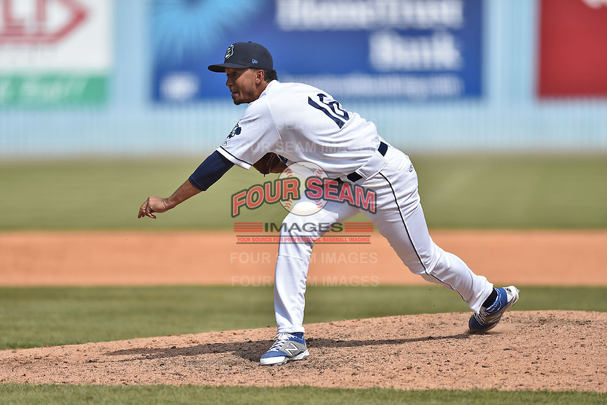 Asheville Tourists pitcher Yoely Bello (16) delivers a pitch during a game against the Lexington Legends on May 3, 2015 in Asheville, North Carolina. The Legends defeated the Tourists 6-3. (Tony Farlow/Four Seam Images)