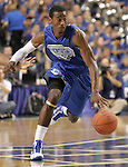 UK guard John Wall dribbles down court during the second period of the Blue and White scrimmage at Rupp Arena Wednesday night..Photo by Zach Brake | Staff