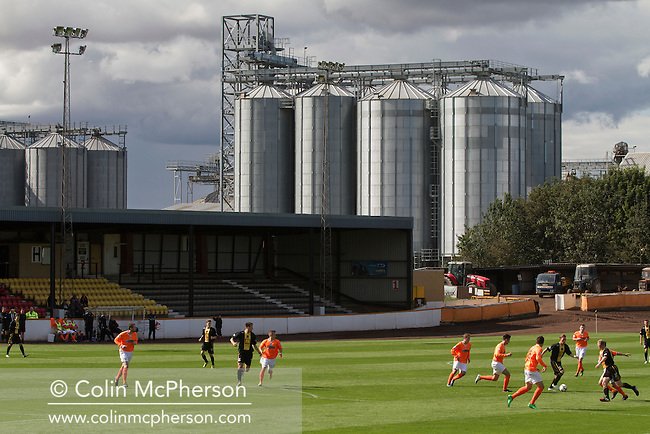 Action from the first half at Shielfield Park, during the Scottish League Two fixture between Berwick Rangers and East Stirlingshire (orange shirts) with the maltings storage silos visible in the background. The home club occupied a unique position in Scottish football as they are based in Berwick-upon-Tweed, which lies a few miles inside England. Berwick won the match by 5-0, watched by a crowd of 509.