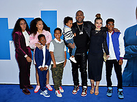 "LOS ANGELES, USA. April 08, 2019: Kenya Barris, Rainbow Edwards-Barris & Family at the premiere of ""Little"" at the Regency Village Theatre.<br /> Picture: Paul Smith/Featureflash"