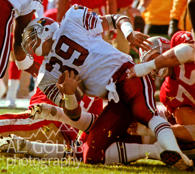 San Francisco 49ers vs. Arizona Cardinals at Candlestick Park Sunday, November 17, 1991.  49ers beat Cardinals 14-10.  Cardinals running back Johnny Johnson (39) tackled by 49ers defensive end Kevin Fagan (75).