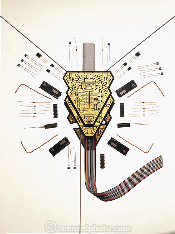 Like a dissected mechanical insect, the hand-sized walking robot Unibug 3.2 (left) reveals its fifty-component construction to the camera's gaze. Designed by Los Alamos , New Mexico, researcher Mark Tilden, Unibug uses simple analog circuits, not the digital electronics that are in most robots, to poke its way around an amazing variety of obstacles. Digital machines must be programmed to account for every variation in their environment, Tilden argues, whereas analog machines can minimally compensate for new and different conditions. From the book Robo sapiens: Evolution of a New Species, page 116.