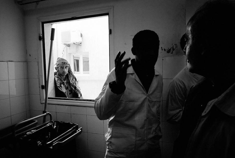 A conversation at Ajdabiya Hospital, Ajdabiya, Libya.