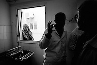 A conversation at Ajdabiya Hospital, Ajdabiya, Libya.