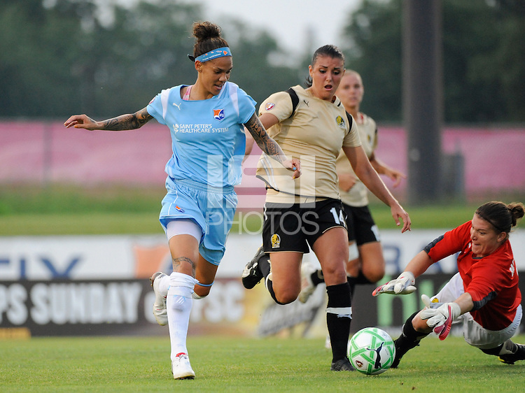 FC Gold Pride goalkeeper Nicole Barnhart (1) takes the ball away from Natasha Kai (6) of Sky Blue FC as Greer Barnes (14) defends during a Women's Professional Soccer match at Yurcak Field in Piscataway, NJ, on August 05, 2009.
