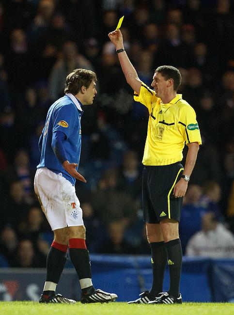 Nikica Jelavic sees yellow from referee Craig Thomson