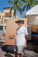 Don Plumridge, Wimauma, Florida, poses in front of his oil painting, during the 23rd Annual Downtown Naples Festival of the Arts, hosted by The von Liebig Art Association and Downtown Association, Naples, Florida, USA, March 26, 2011. Photo by Debi Pittman Wilkey