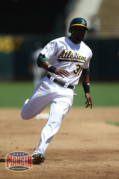 OAKLAND, CA - AUGUST 14:  Brandon Allen #31 of the Oakland Athletics runs the bases against the Texas Rangers during the game at O.co Coliseum on August 14, 2011 in Oakland, California. Photo by Brad Mangin