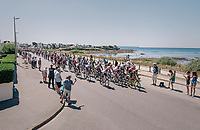 peloton rolling by the Atlantic Ocean at the start of the stage<br /> <br /> Stage 5: Lorient &gt; Quimper (203km)<br /> <br /> 105th Tour de France 2018<br /> &copy;kramon