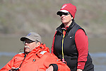 Washington State head rowing coach, Jane LaRiviere, and University of Washington head rowing coach, Bob Ernst, watch from a chase boat as the 15th ranked Washington State University women's varsity rowing crew compete against the 7th ranked University of Washington in dual action at Wawawai Landing on the Snake River near Pullman, Washington, on April 9, 2011.  The Huskies swept the regatta and regained the Apple Cup for winning the varsity eight race.